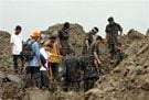 Rescuers search for landslide survivors 