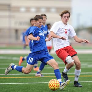 <p>Chandler's Frank Stein (18) winds up to kick the ball during the Coyote Classic Soccer Tournament at Campo Verde High School on December 6, 2014.</p>