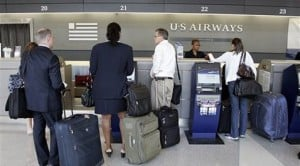 US Airways to continue charging extra fees
