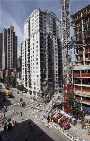 NYC crane collapses into street, killing 2 workers