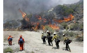 Two big wildfires merge in Southern California