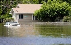 3 homes washed away in Wis.; Midwest rivers swell