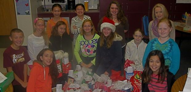Gilbert elementary students make holiday packages for hospice
