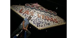 Artist builds Vegas sign with cards, dice