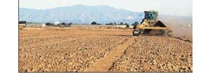 Satellite-guided tractor system aims at improved farm efficiency