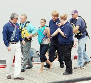 Woman Pulled From River