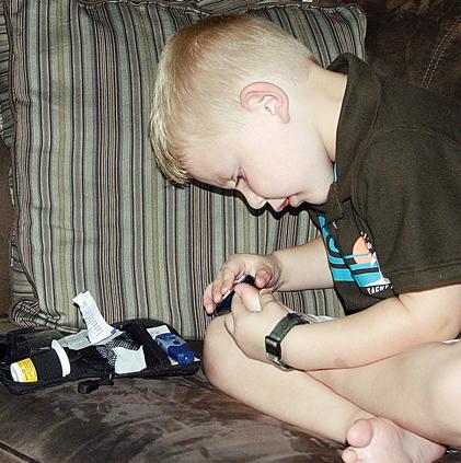 Checking His Blood Sugar