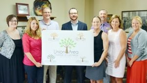 <p>The Union area Chamber of Commerce unveiled its new logo Monday at the Chamber office. It was designed by Tyann Marcink, of Marcink Designs. Pictured, from left, are Chamber Executive Director Aimee Frey, Marcink, Chamber board members Greg Toelke, President Jon Martin, Stacy Rio, Aaron Hall, Tammy Weinhold and Assistant Chamber Director Megan Meyer.    Missourian Photo.</p><p></p>
