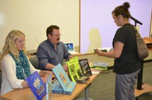 Sign Books Following Presentation at Washington Public Library