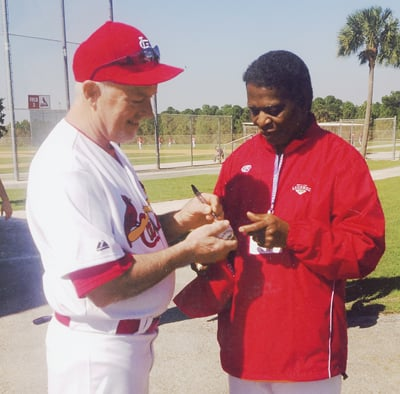 Giving Lou Brock His Autograph