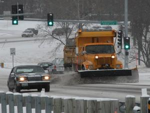 Snow Plow Clears Roadway