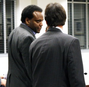 Confers with Attorney
