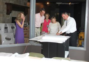 <p>East Central College trustees had the opportunity to tour the renovation progress at its new business and industry center Thursday, July 21. The center is located adjacent to the main campus and will house the precision machining, industrial engineering technology and HVAC programs. Here, trustees review plans in the lobby of the building. From left are Julie Stroetker, trustees Dr. Joe Stroetker, Cookie Hays, Ann Hartley and Dr. Jon Bauer, college president.  Missourian Photo.</p>