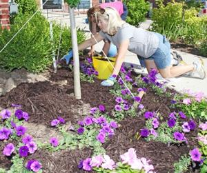 Planting Flowers at Downtown Post Office