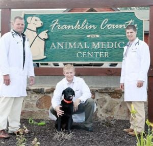 <p>The Franklin County Animal Medical Center in Washington in September will mark its 10-year anniversary in business. The clinic has three veterinarians. From left they are Hunt Tainter, DVM; Spencer Thompson, DVM; and Zack Dombek, DVM. They are pictured with dog Laney. Missourian Photo.</p><p></p>