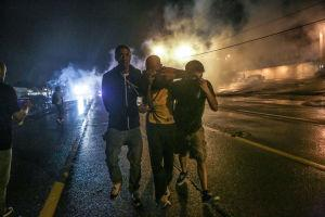 Police Use Tear Gas to Disperse Crowds
