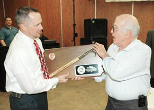 Presents Plaque to Dale Sullivan