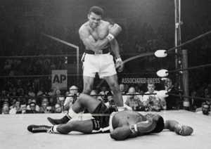 <p>FILE - In this May 25, 1965, file photo, heavyweight champion Muhammad Ali, then known as Cassius Clay, stands over challenger Sonny Liston, shouting and gesturing shortly after dropping Liston with a short hard right to the jaw, in Lewiston, Maine. Ali, the magnificent heavyweight champion whose fast fists and irrepressible personality transcended sports and captivated the world, has died according to a statement released by his family Friday, June 3, 2016. He was 74. (AP Photo/John Rooney, File)</p>