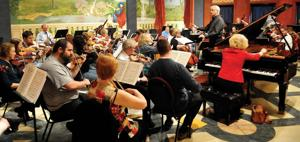 <p>Dough Newell conducts a rehearsal of the Enid Symphony Orchestra. (Staff File Photo by BILLY HEFTON)</p>