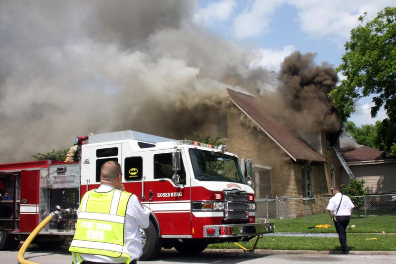 Rosenberg house fire threatens nearby structures