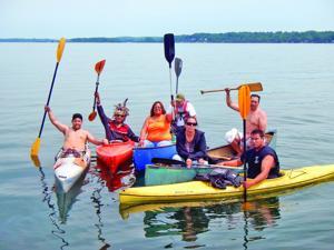 Cayugas paddle across Cayuga Lake