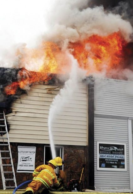 Breaking news firefighters battle blaze in downtown north for A little off the top salon