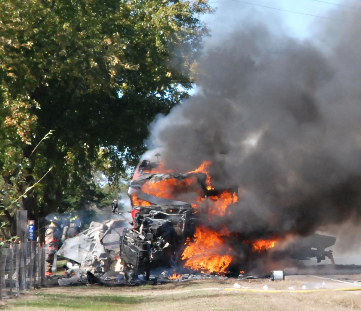 Crash Kills 2, But Injured Man Pulled From Burning Semi
