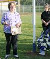Linda Todd speaks by flagpole