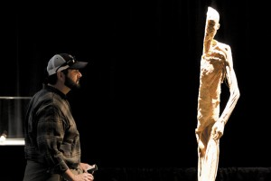 <p>Todd Rinaldi looks at a body that has been cut in half at the 'Our Body Within' exhibit at the Alaska State Fair in Palmer Wednesday afternoon. The exhibit will stay at the Sheldon Arts Building for an additional week after the fair closes for school group tours.</p>