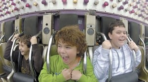 <p>Kalvin Maher, Haley Hight and Gabe Fish are strapped intoGolden Wheel Amusement's 1001 Nachts ride at the Alaska State Fair in Palmer Friday afternoon. This ride is No. 3 on their list of exciting fair rides because of its fast drop and that it gets above the ground.</p>