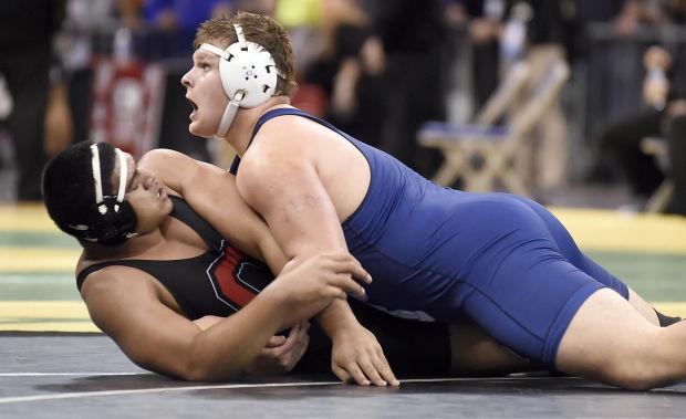 Prep wrestling: Iademarco escapes for title