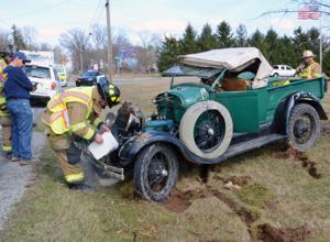 Crash damages antique vehicle