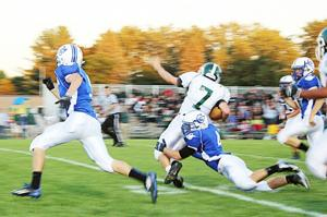 Brandon Wackerle, #4, tackles a Clare player in last Friday's matchup.
