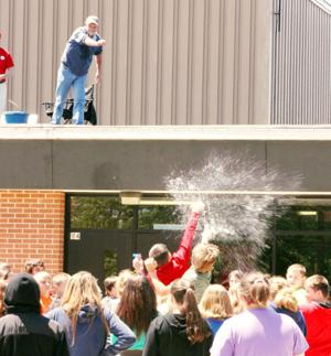 Interim Superintendent, Dave Marston, hits his target, defending his position on the BMS roof.
