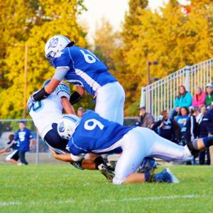 Landon Grove, #9, and Lewi Janiga rustle down a mustang in Friday's Homecoming game with Meridian.