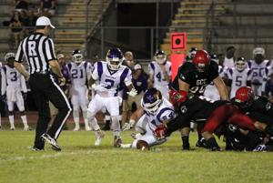 <p>Glendale's Nate McLaurin knocks the ball loose from Eastern Arizona running back Tevin Horton. Horton was able to recover the fumble.</p>