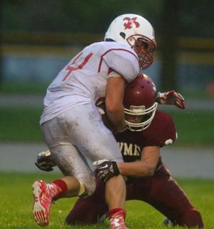 Photos: St. Ansgar at Newman Catholic football