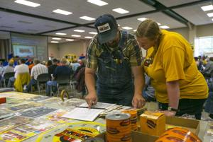 Vintage farming memorabilia auction draws a crowd