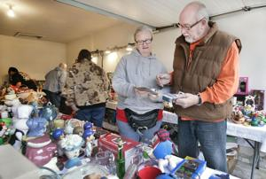 Cold, rainy weather doesn't stop garage sales