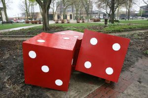 Dice will stay in park, but move from flower bed