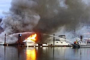 Boats burn at Shelter Bay; six sunk, one destroyed
