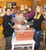 <p>Members of La Conner Middle School's Teen Outreach program packed an entire pallet of carrots into bags for people coming to Helping Hands Food Bank in Sedro-Woolley on Wednesday, Feb. 18. The food was dispersed to food bank visitors later that day. Submitted photo</p>
