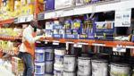 <p>Prince Addy of Manassas, Va., straightens up the shelves of roofing products on Feb. 23 at a Home Depot store. The first step in roof maintenance may be to get out a pair of binoculars and take stock. (AP Photo/Susan Walsh)</p>