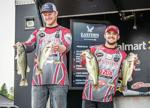 <p>Tyler Wasilewski (left) and fishing partner Cy Floyd hold up their Day 2 catch at the FLW College Fishing National Championship in South Carolina on April 17. Photo courtesy FLW</p>