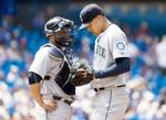 <p>Seattle pitcher Taijuan Walker (right) talks with catcher Welington Castillo after allowing four fifth-inning runs Sunday.</p>