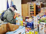 "<p>Wedge Antilles, an U.S. Air Force veteran who served during Desert Storm, looks through the boxes and cans of donated food at the Veterans Stand Down on Thursday, March 26, in Burlington. ""I mostly just get cereal so I have something to eat when I take my medicine,"" Antilles said. Brandy Shreve / Skagit Valley Herald</p>"