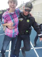 <p>La Conner eighth-grader Cole Ellis and Skagit County Sheriff's Deputy Jeff Willard jointly maneuver in a three-legged race hosted May 6 by the Teen Outreach Program at La Conner Middle School. Submitted photo</p>
