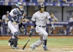 <p>Seattle's Robinson Cano (right) watches his RBI single off Tampa Bay Rays relief pitcher Steven Geltz during the eighth inning Monday.</p>