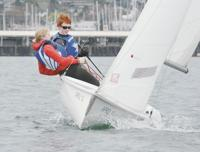 <p>Anacortes High School sailing team members Julia Soes and Christopher Warmuth lean into the windward side of their boat during practice Thursday, March 19, in Fidalgo Bay. Scott Terrell / Skagit Valley Herald</p>