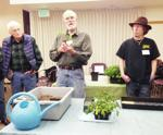 <p>Bob Bryan (center) demonstrates the proper process for transplanting tomato seedlings to John McMillin (left), Jonathan Robbins and other Skagit County Master Gardener interns during a training session on Feb. 3 at the Padilla Bay Interpretive Center in Bay View. Emma Davis / Skagit County Master Gardeners</p>